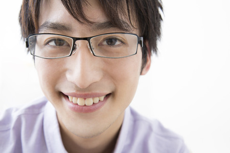 loosen up: Man smiling over glasses Stock Photo