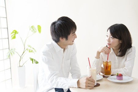 image date: A couple chatting in the Cafe Stock Photo