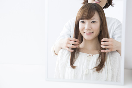 Woman smiles at beauty salon