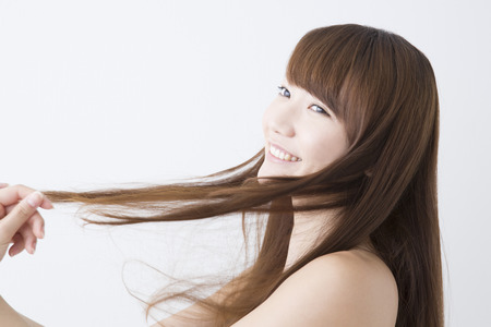 Woman smiling and touching the hair