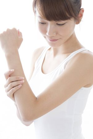 Woman touching the arms Stock Photo