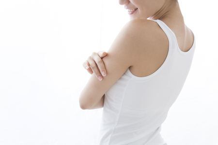 Woman touching the upper arm Stock Photo