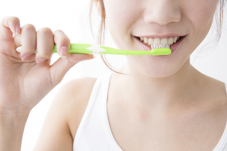 Women brush their teeth