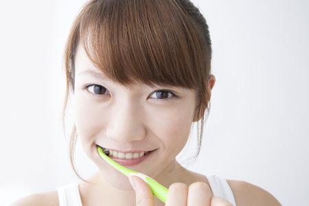 adult brushing teeth: Women brush their teeth