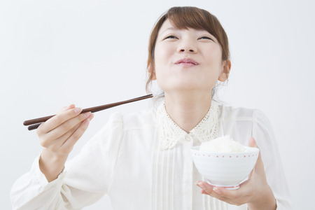 Women to eat rice Stock Photo