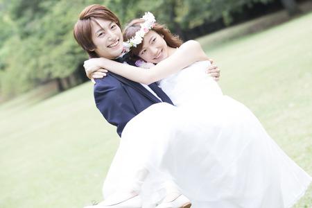 Bride and groom to princesses hug