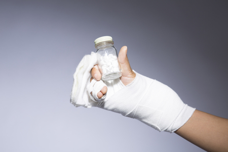 painkiller: Hands are bandaged with a medicine Stock Photo