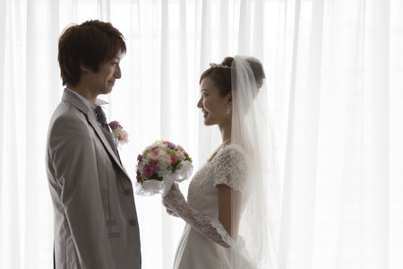 Bride and groom facing