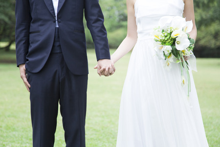 Bride and groom holding your hand