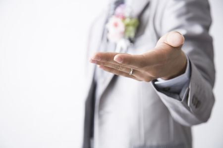 Groom to hold out the hand
