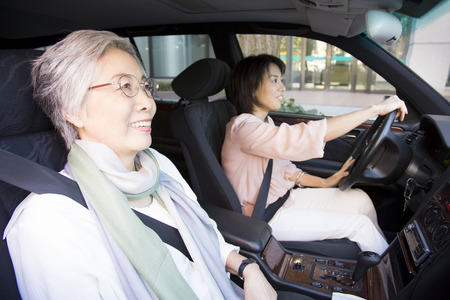 woman driving: Daughter and mother to drive a car