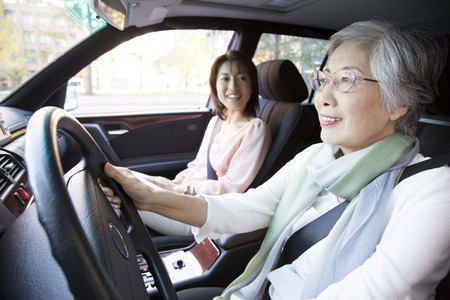 step daughter: Mother and daughter to drive a car Stock Photo