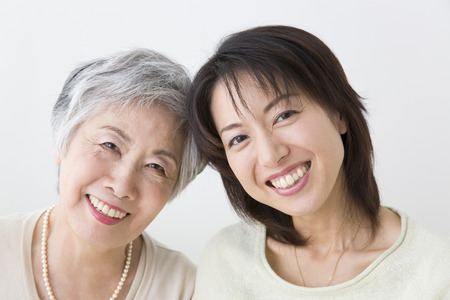 Smiling mother and daughter 스톡 콘텐츠