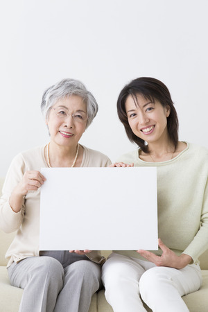 step daughter: Smile with a message board smiling mother and daughter