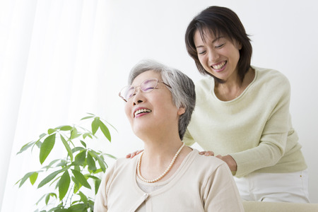 Mother to get a massage to daughter Stock Photo