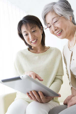 Mother and daughter to see the tablet PC Stock Photo