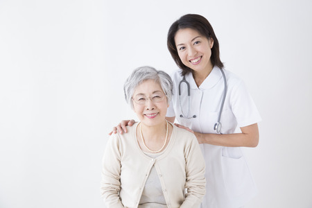 Smiling senior woman and nurse
