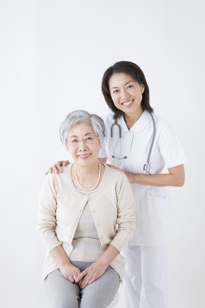 salubrious: Smiling senior woman and nurse
