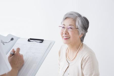 a medical examination: Senior women undergoing medical examination