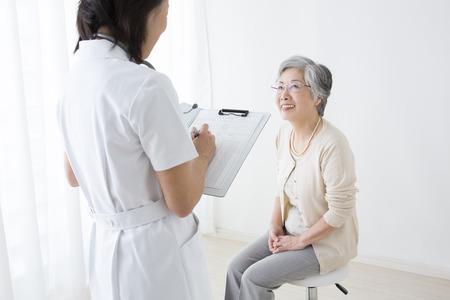 sixty: Senior women undergoing medical examination
