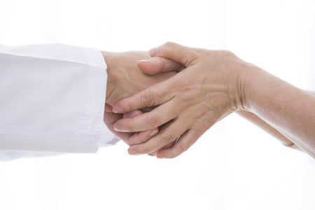 salubrious: Hand of senior women and female doctor shaking hands