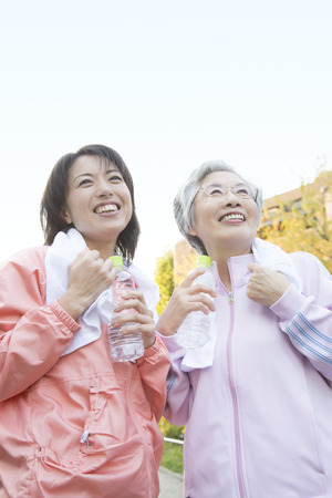 Daughter and mother to rest after exercise photo