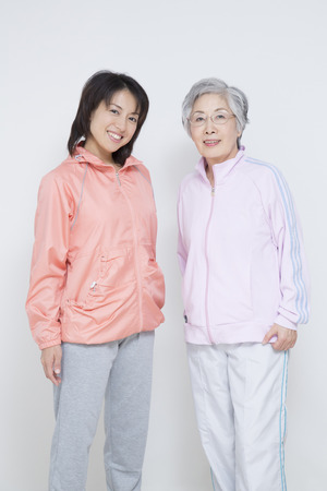 Sportswear up mother and daughter photo