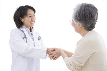 Senior women to shake hands with female doctor Stock Photo - 43795886