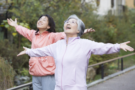 Mother and daughter to take a deep breath Stock Photo