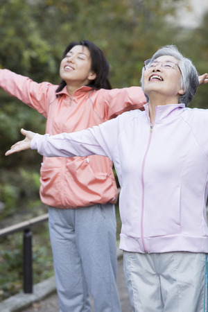 pliable: Mother and daughter to take a deep breath Stock Photo