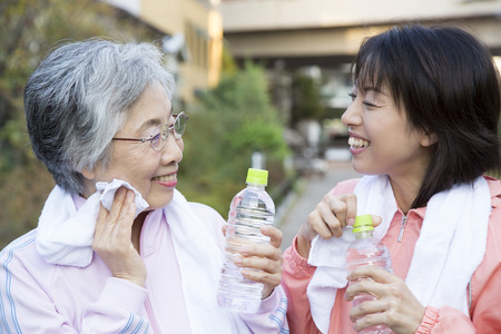step daughter: Daughter and mother to rest after exercise Stock Photo