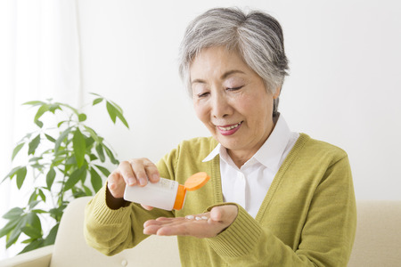 Senior women who drink tablets Stock Photo