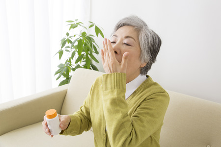 supplementary: Senior women who drink tablets Stock Photo