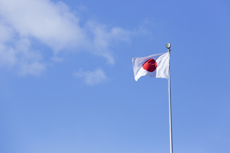 japanese flag: Trail in the wind Japanese flag Stock Photo