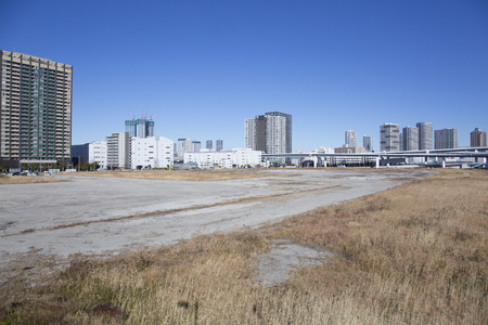 Vacant land and skyscrapers