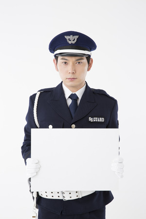 message board: Security guard with a message board