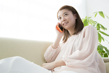 loosen up: Women call on the couch Stock Photo