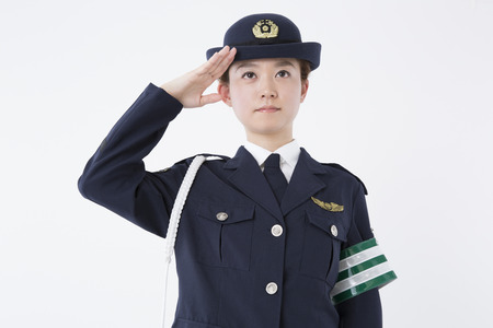 female police: Female police officers to the salute Stock Photo