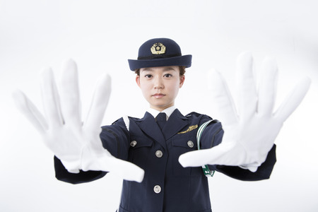 female police: Female police officers to hold up both hands Stock Photo