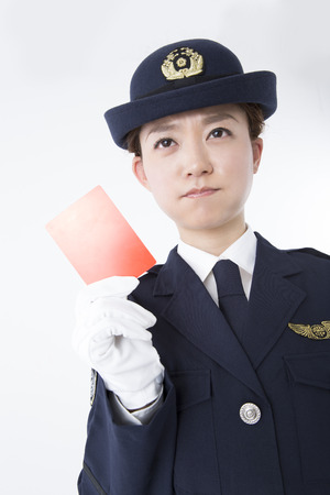 female police: Female police officer with a red card Stock Photo