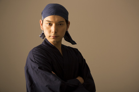 Japanese cook to his arms folded Stock Photo