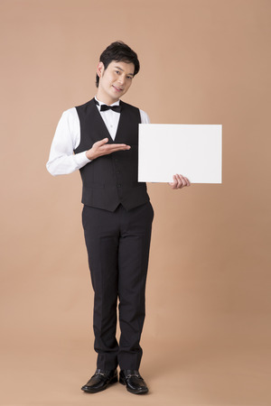 message board: Waiter with a message board