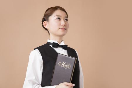 Waiter with menu photo
