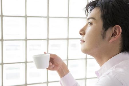loosen: Men drink coffee Stock Photo