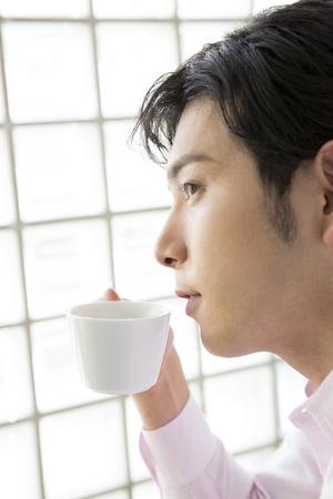 loosen up: Men drink coffee Stock Photo