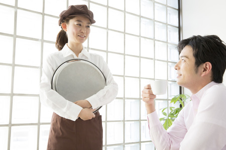 Cafe clerk to customer service Stock Photo