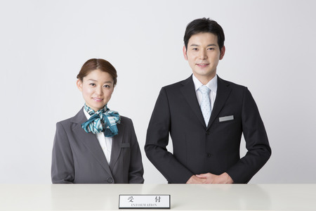 The front desk staff portraits 스톡 콘텐츠