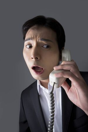 hoodlum: A telephone man Stock Photo