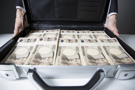 attache: Men show a container with a lot of money in attache case