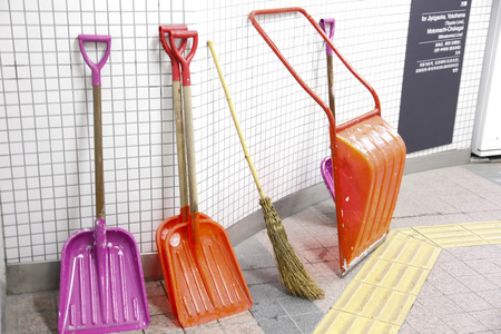 shoveling: Snow shoveling tool that is propped up in train stations in Tokyo